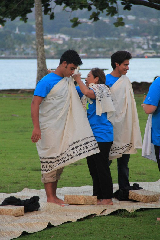 Students get their kihei tied prior to the hō'ike ceremonies