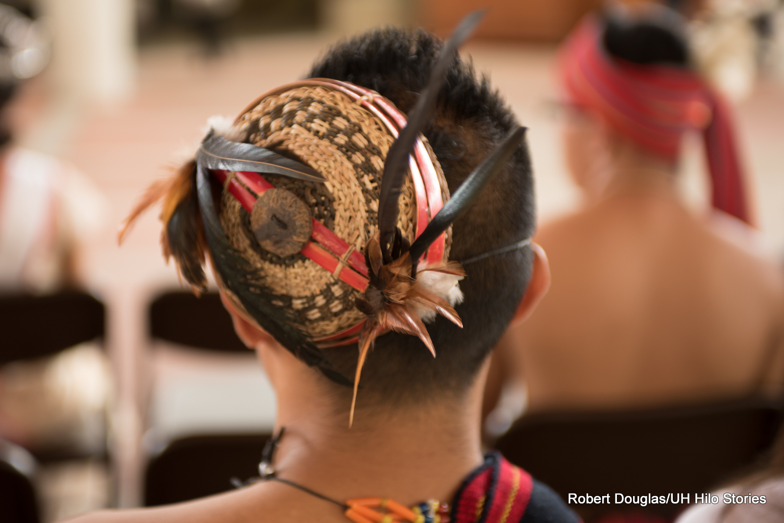 Close up of woven hair ornament.