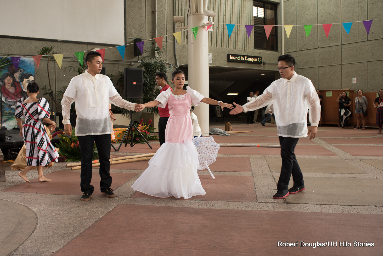 Couple daning in white fluffy costumes.