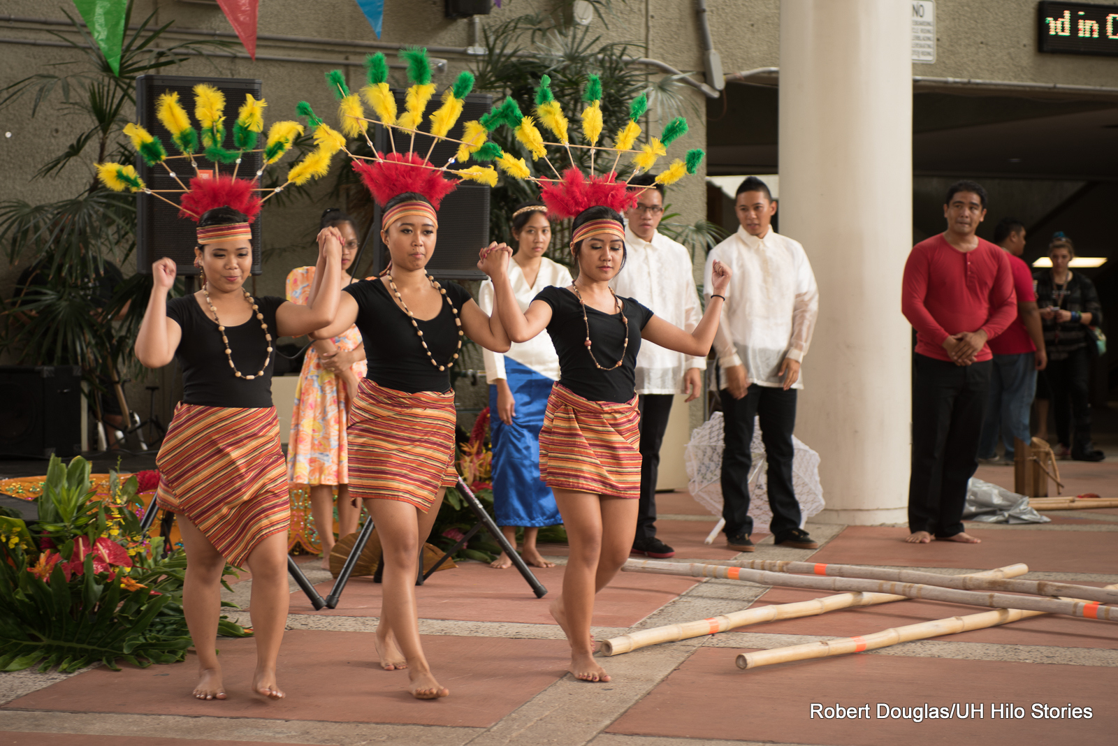 Women dancing with headdresses and sarongs.
