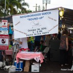 "Sign over booth: Neighborhood Watch ""Round Up."""