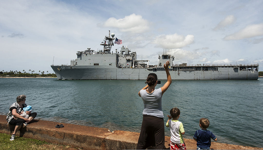 Family waves good-bye to departing ship.