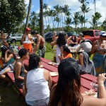 Large group gatherd at canoe shack.