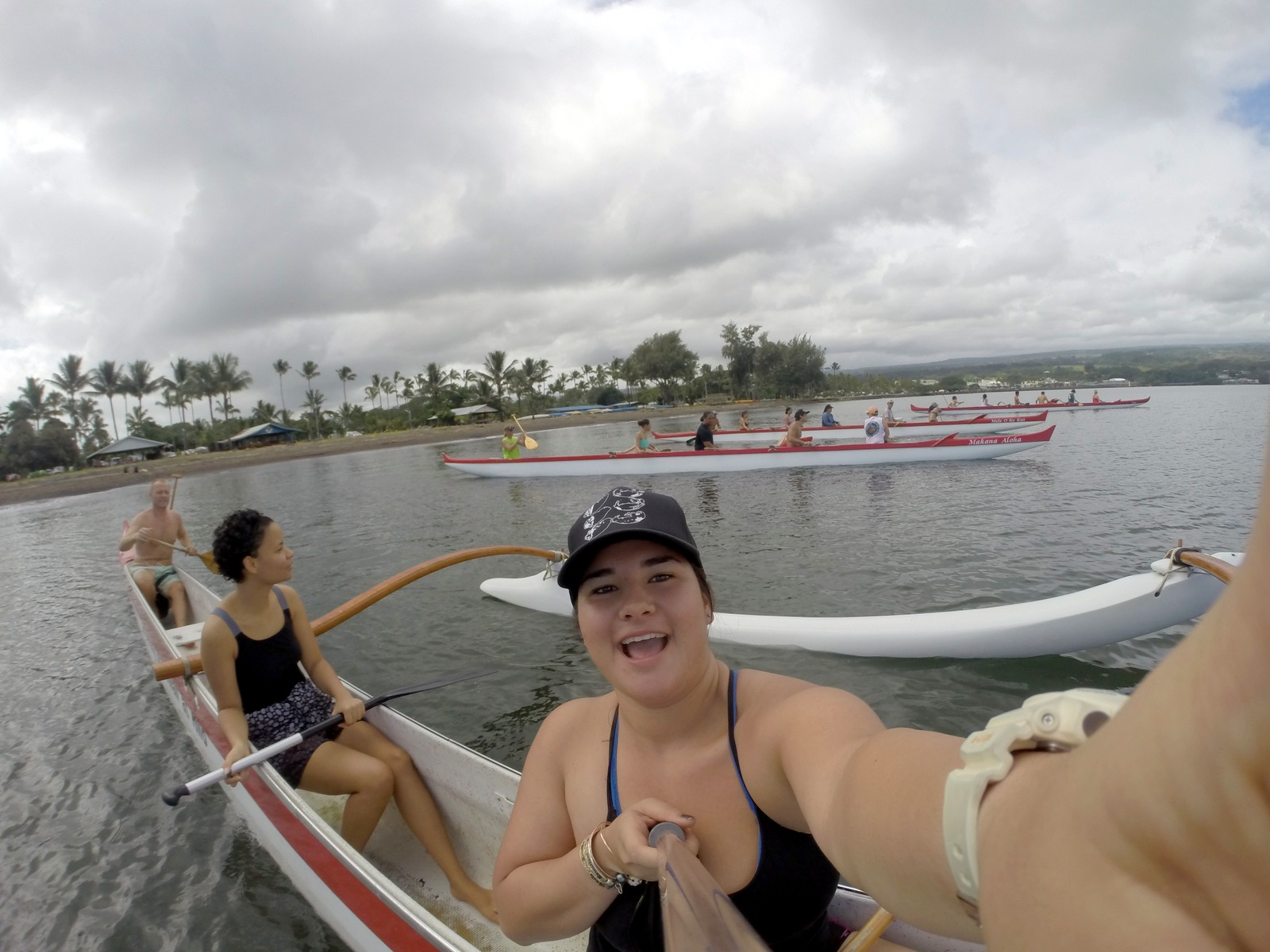 Student taking selfie on canoe.