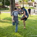 Men playing game of balance.