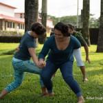 Women playing game of balance.
