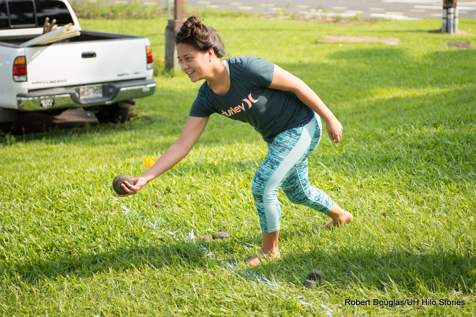Woman playing game of toss.