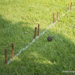 Sticks on ground marking white lines.