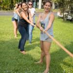 Women pulling rope.