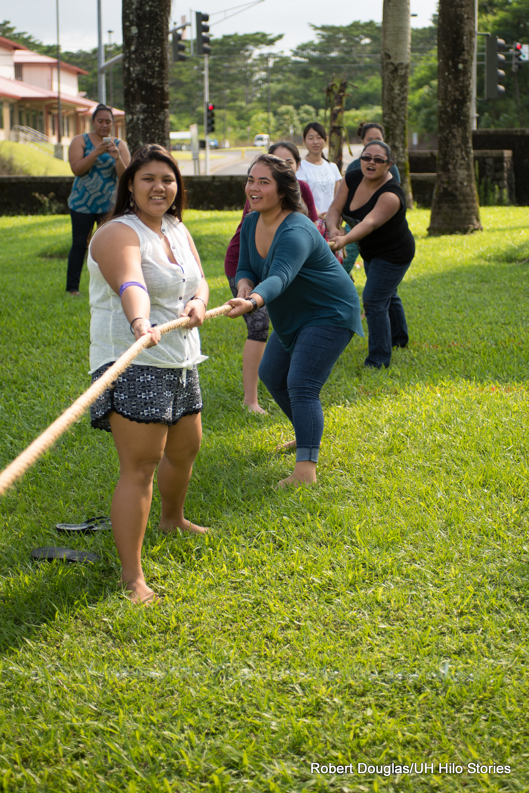 Women getting ready to pull rope.