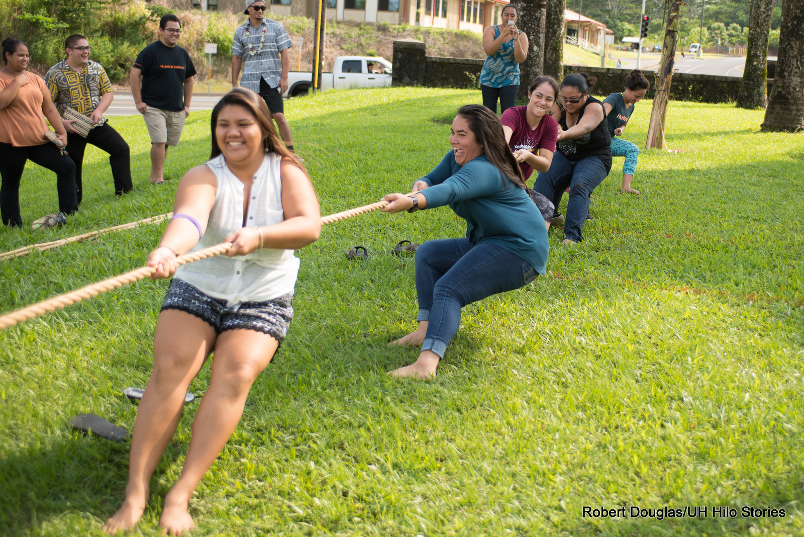 Hukihuki, Hawaiian Tug of War. Opponents pull on opposite ends of a long rope. The game ends when one team gets pulled to the other's side.
