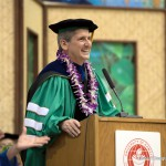 UH President Lassner at podium.