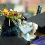 Mortarboard with flowers.