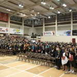 Wide view shot of venue with candidates and audience.