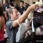 Someone giving graduate a lei.