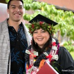 Graduate with lei.