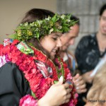 Graduate with lei.