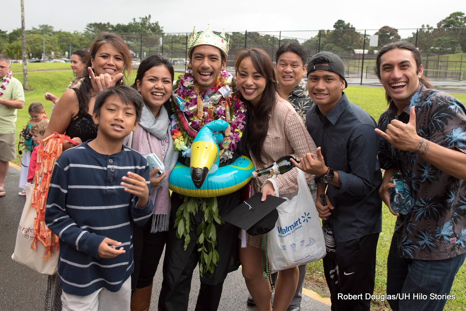 A graduate celebrates after Commencement with family and friends.