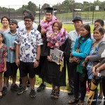 Two graduates with family and friends.