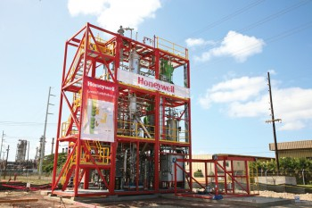 The construction phase of an integrated biorefinery in Kapolei, Hawaii. Large red metal structure.