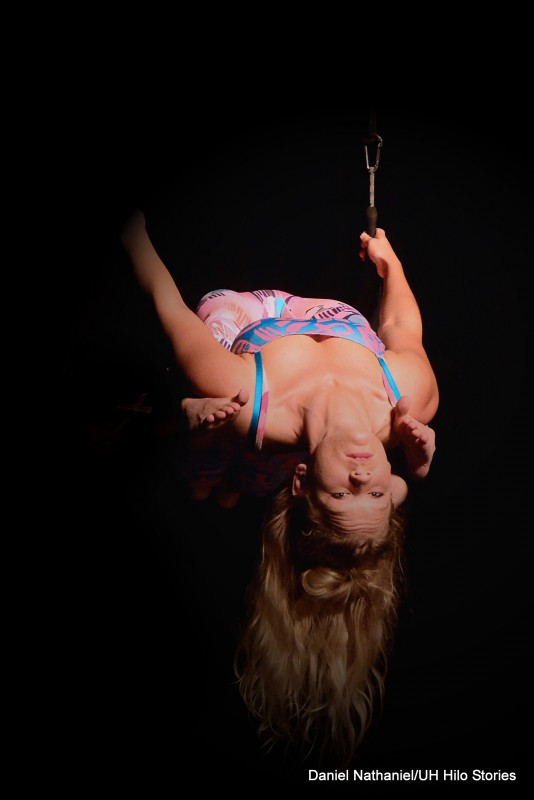 Woman doing acrobats suspended in air.