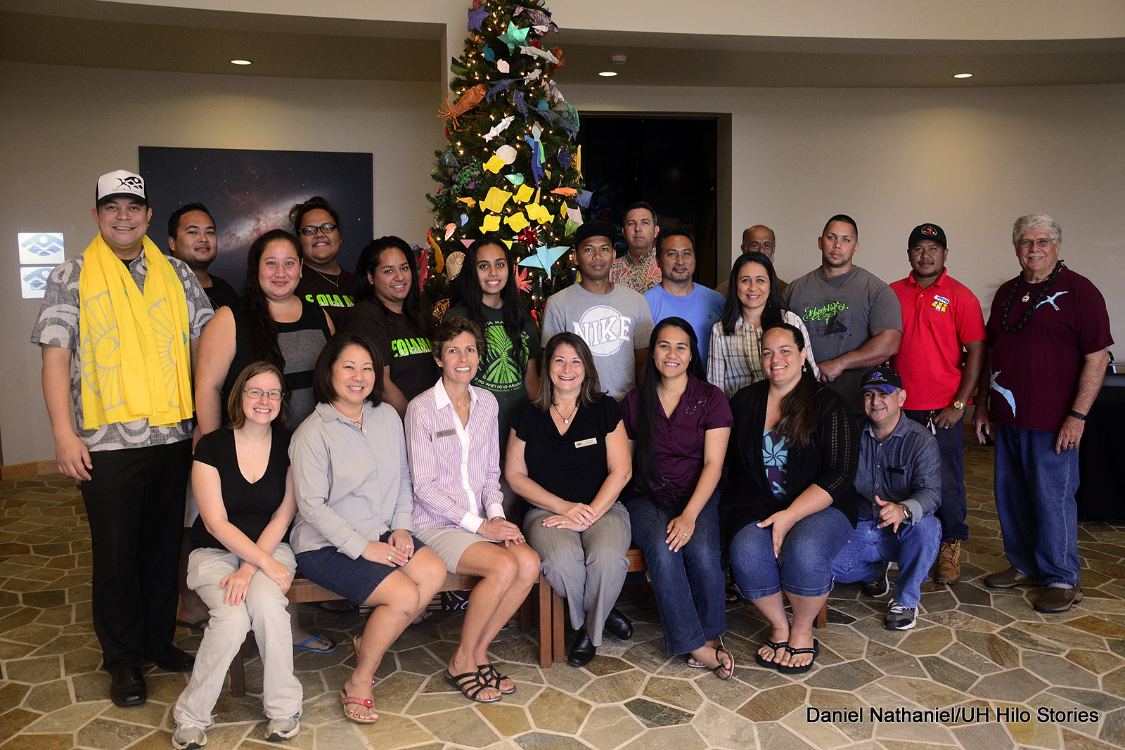 Group photo of 'Imiloa staff with holiday tree in background.