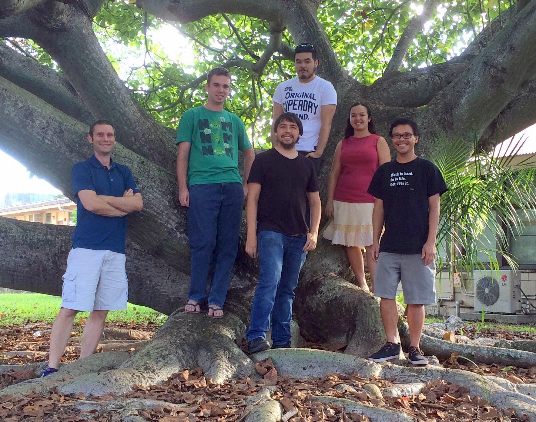 Group of student near monkey pod tree.