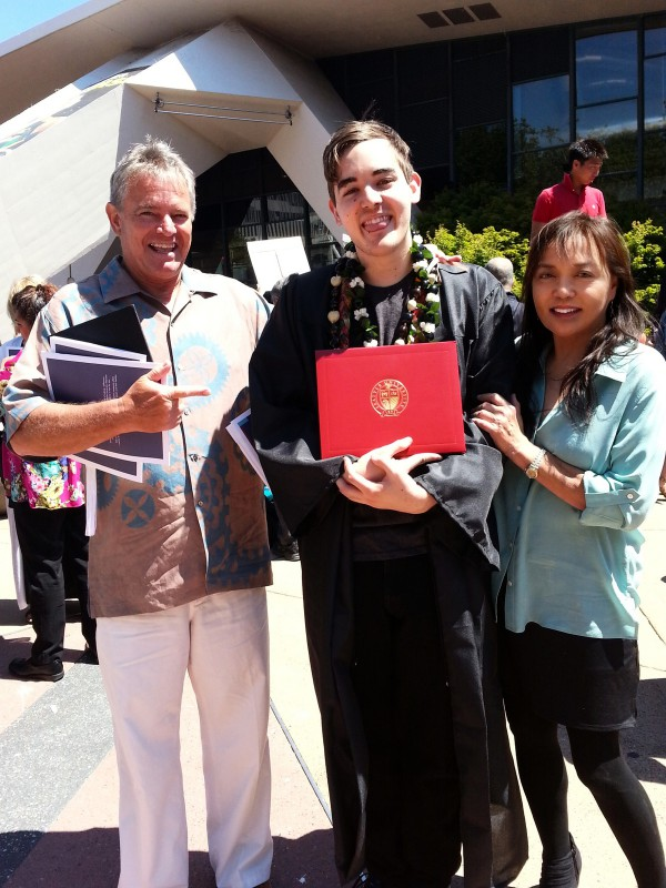 Corey Patton stands with his parents at graduation.