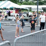 Kids dancing in front of stage.