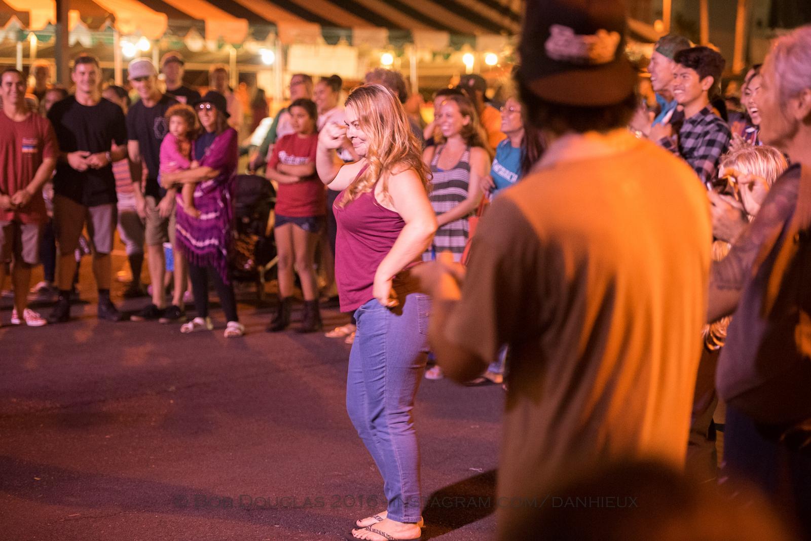 Woman in audience dancing.