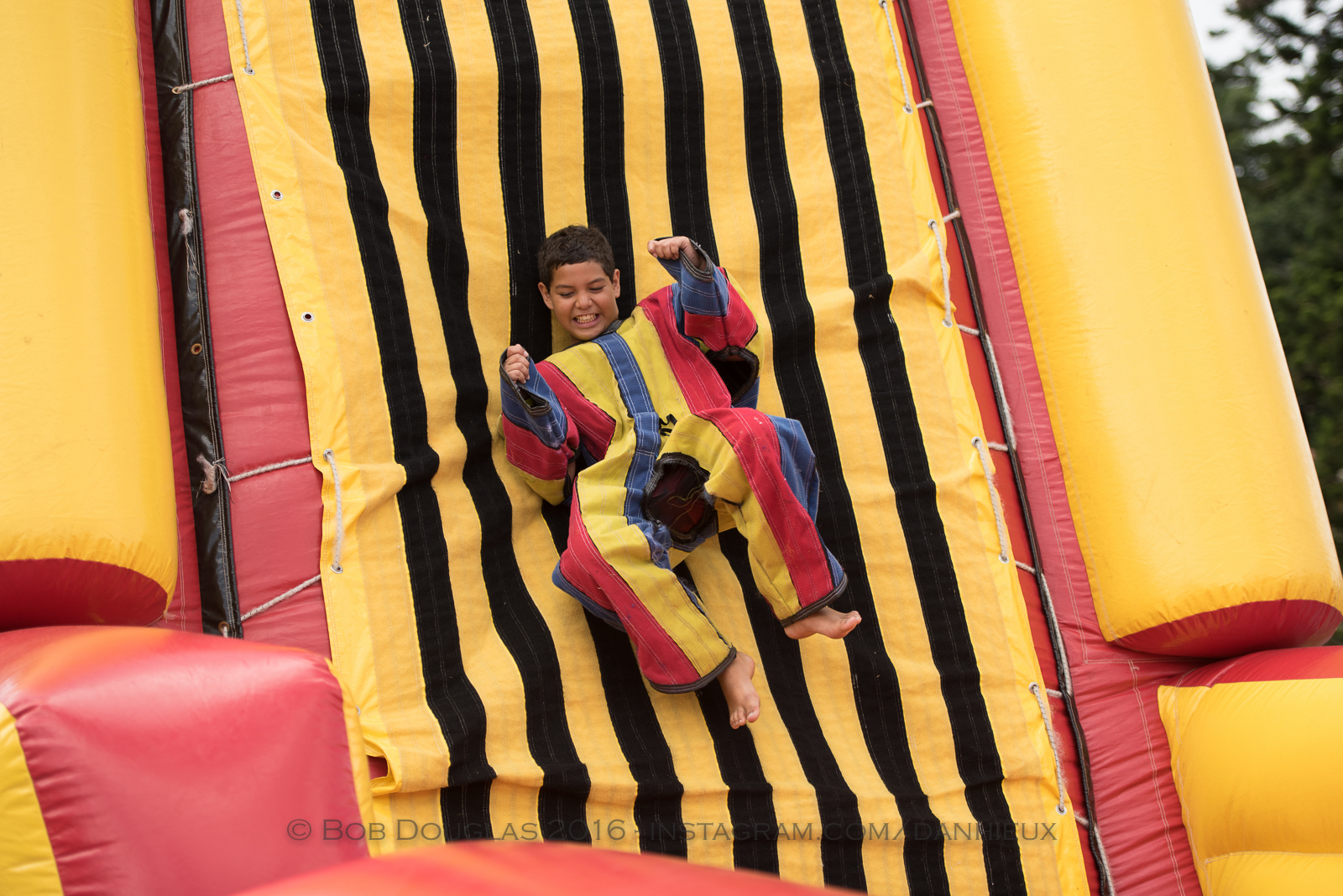Kid coming down slide.