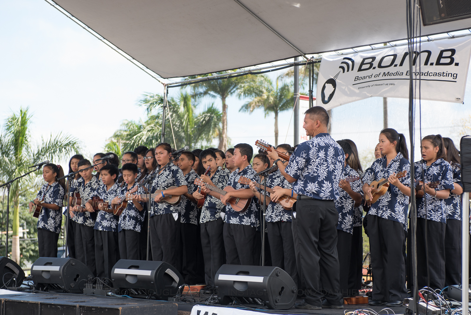 Group of young ukulele players on stage.