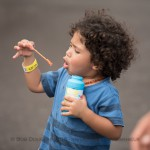 Kid blowing bubbles.