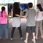 KIds playing games with LED screen.