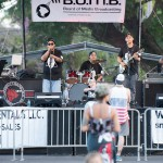 Band playing musical instruments on stage.