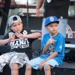 Kids sitting near stage.