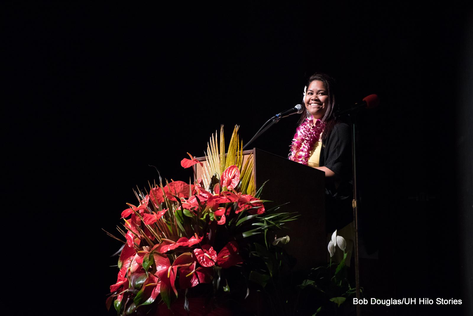 Woman at podium.
