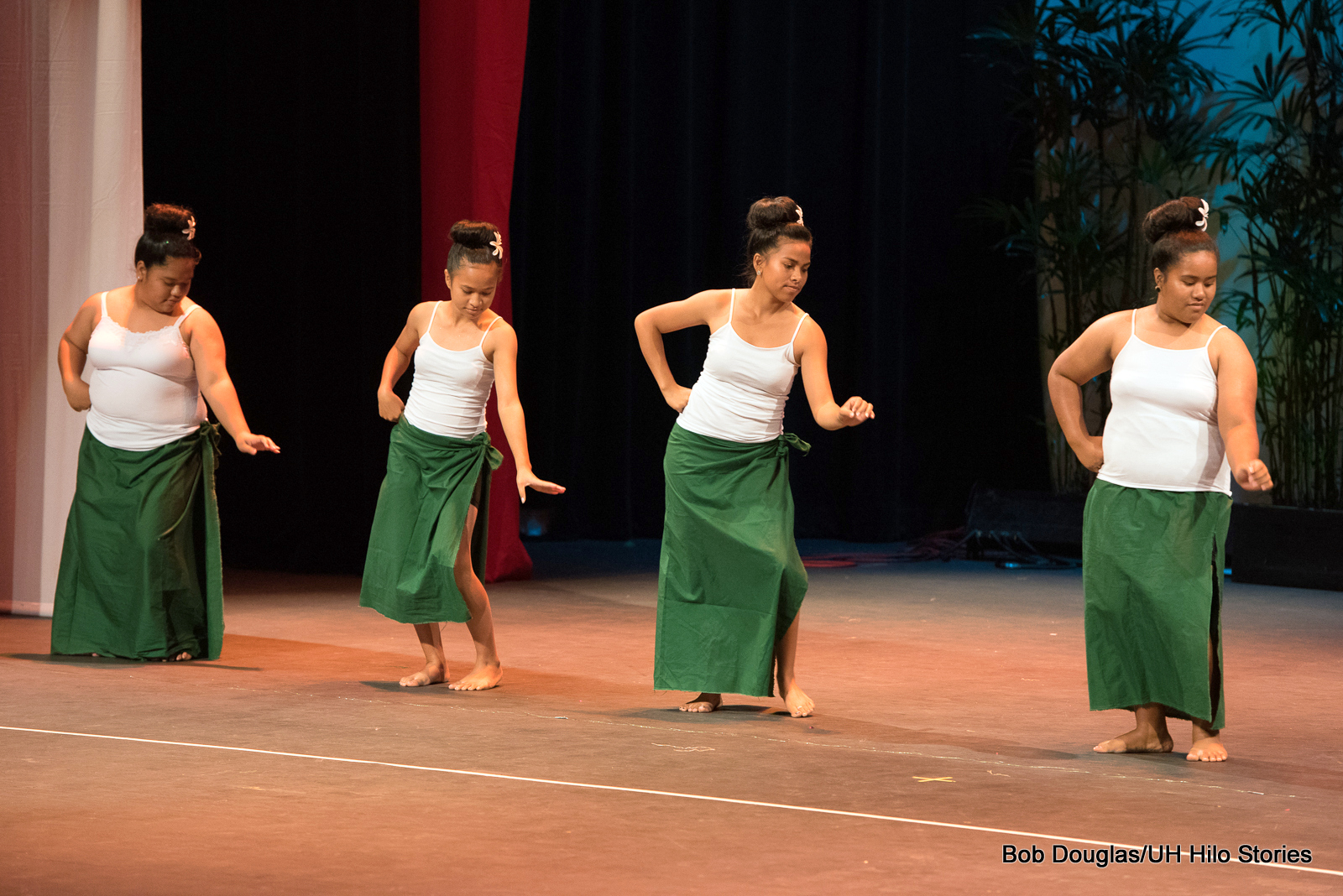 Women dancers in green and white.