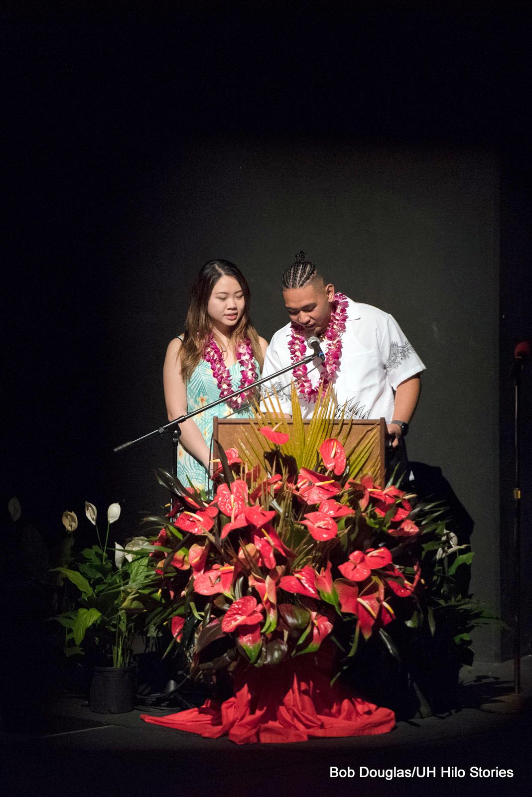 Man and woman at podium.