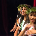 Women dancing. Leaf wreath on head, lavalava, barefoot.