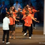 Group in orange, dancing,.