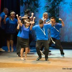 Group in blue dancing.