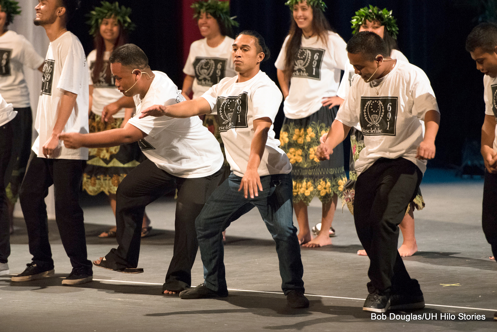 Male dancers at front.