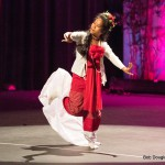 Single woman dancing on stage, Burmese attire, red and white costume,.