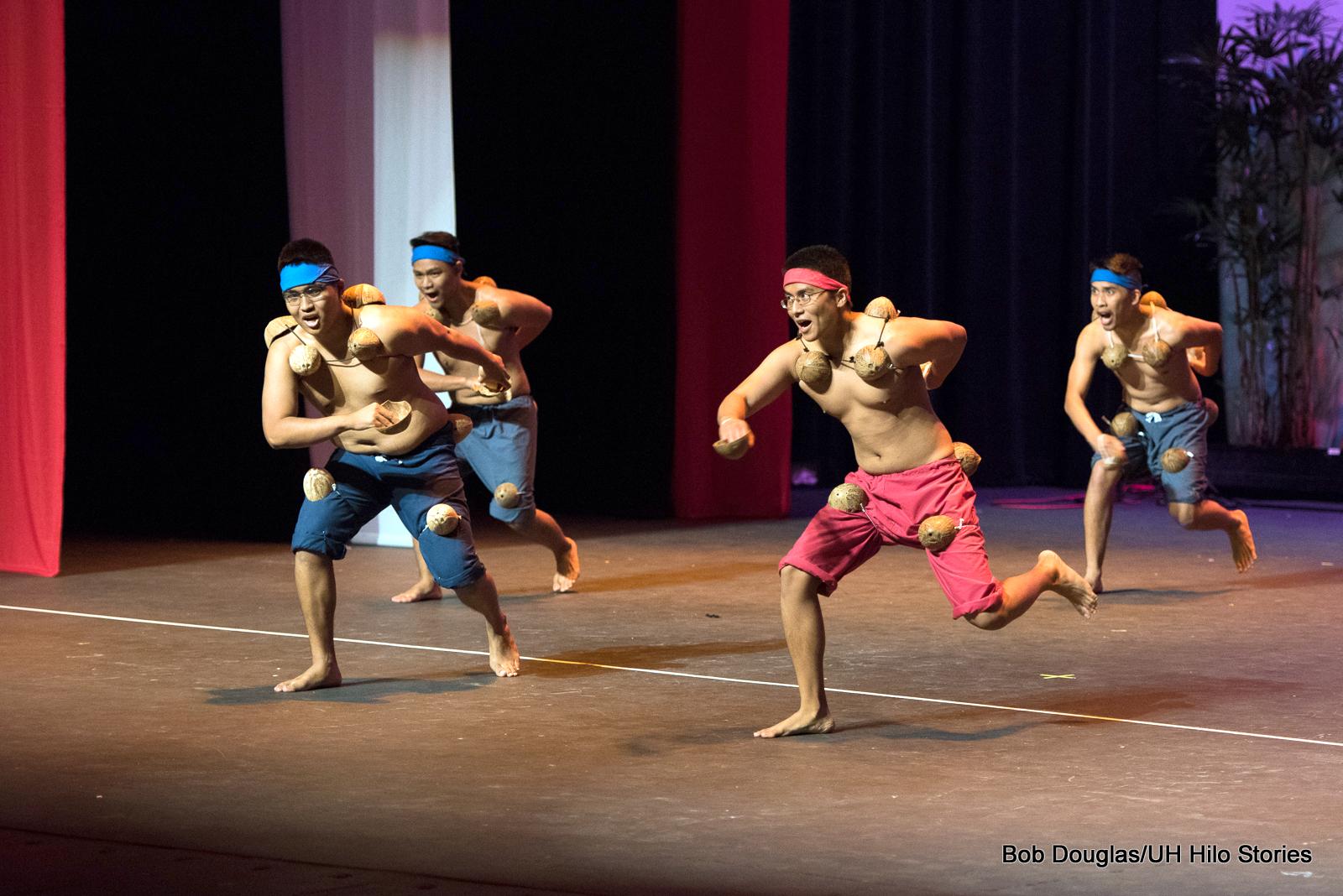 Men dancing.
