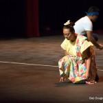 Single woman bowing.
