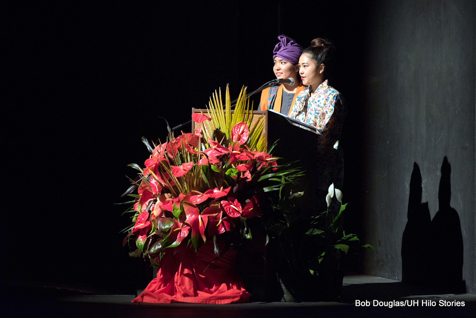 Two women at podium.