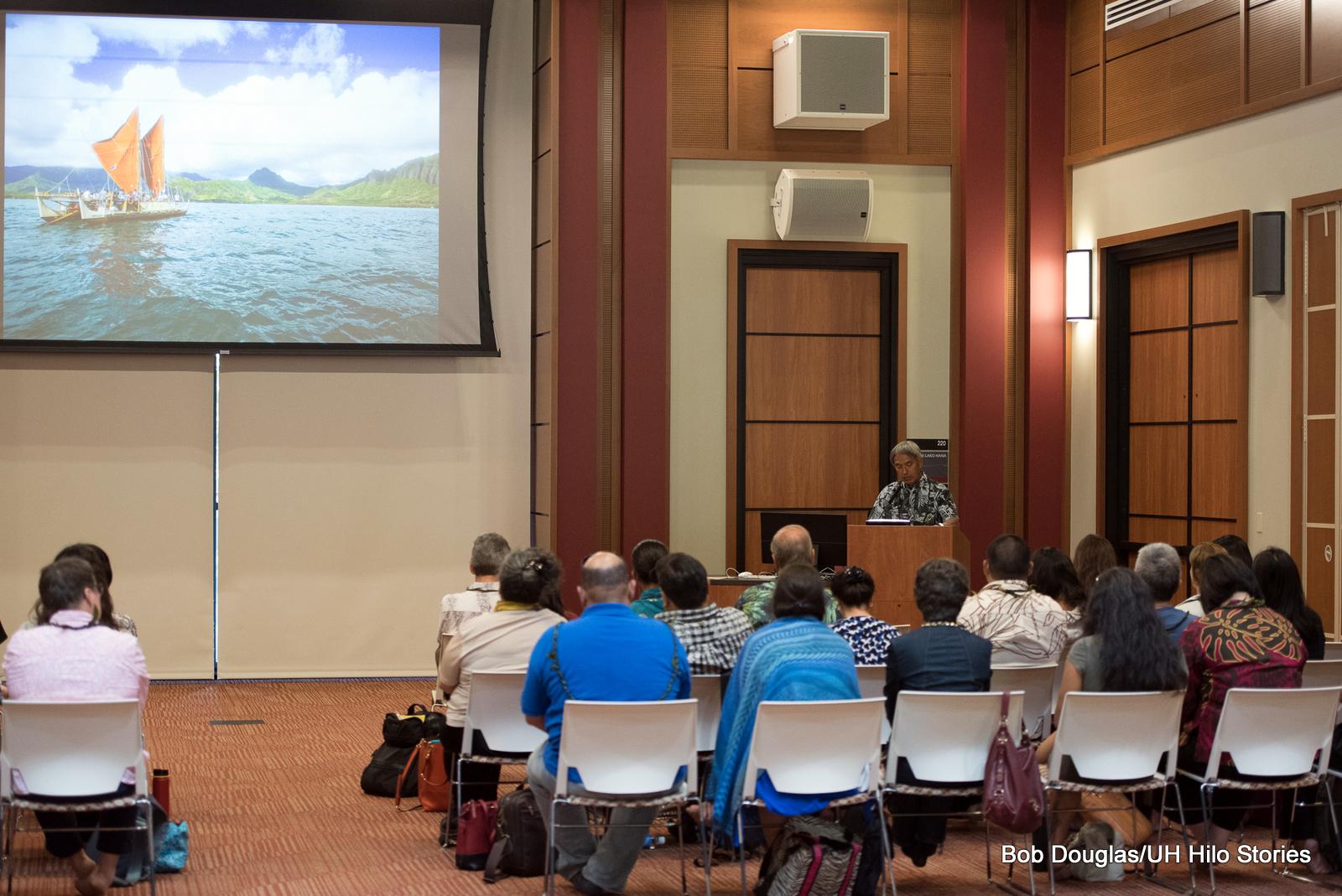 Nainoa Thompson speaks to group in auditorium.