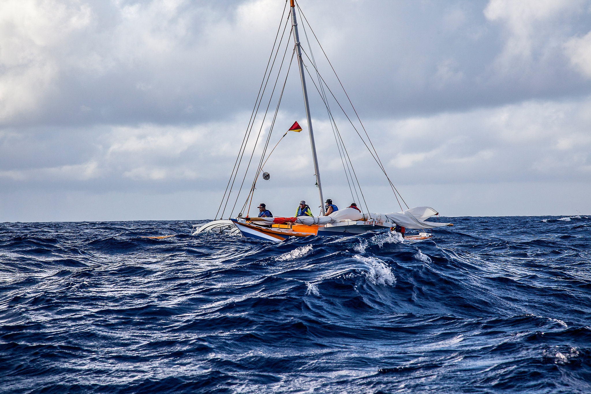 Sailing canoe at sea.