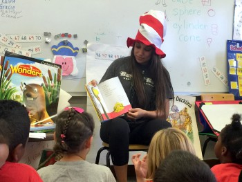 Alia Alvarez reads to school children.